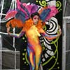 Beautiful entertainer in colorful body suit and feathers boosts entertainment value of New York City event
