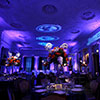 Blue and purple ambient lighting design inside expansive NYC venue hall
